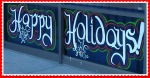 Happy holidays window greeting painted on lower window panes