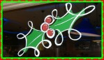 holly and berries painted on glass in vivid colors